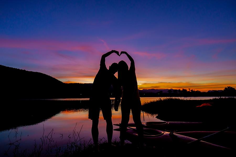 bigstock Loving Couple Showing Heart Sy 430629566