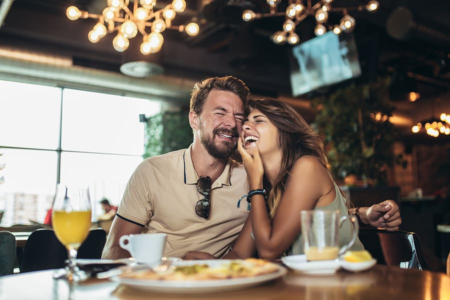 bigstock Young Happy Couple Eating Pizz 333383146